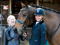 """Smiles All Around"" -- Horse & rider get ready for a warm-up prior to entering their first competiti"
